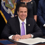 New York Gov. Andrew Cuomo signs legislation designed to increase the statewide minimum wage to $15.