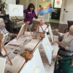 Bonnie Parton leads a painting class for residents at Dominion Senior Living of Johnson City.