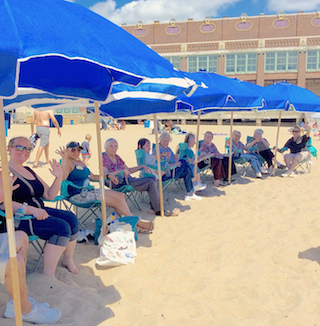 Residents and staff from five Brandywine Living communities connect at Asbury Park beach.