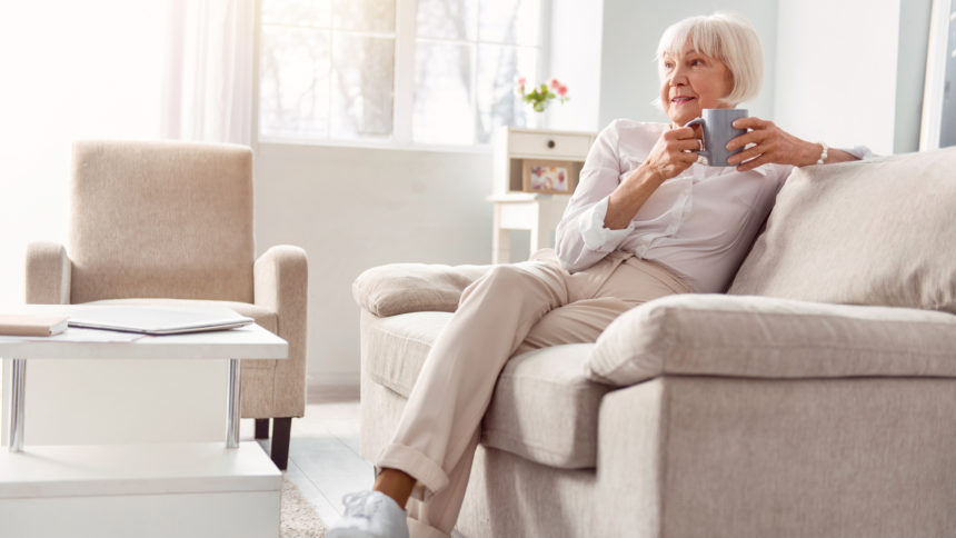 Women drinking coffee in assisted living unit