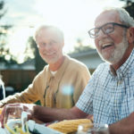 A group of older adults happily socializing