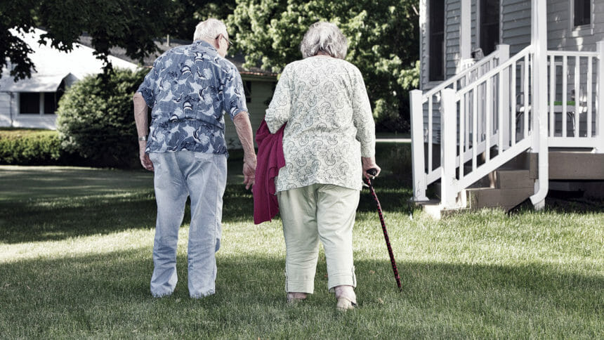 Elderly couple walking outside