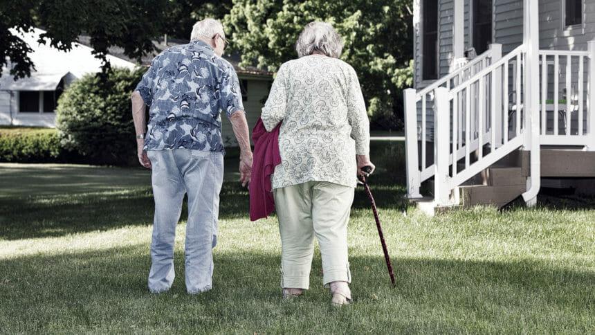 Elderly couple walking outside