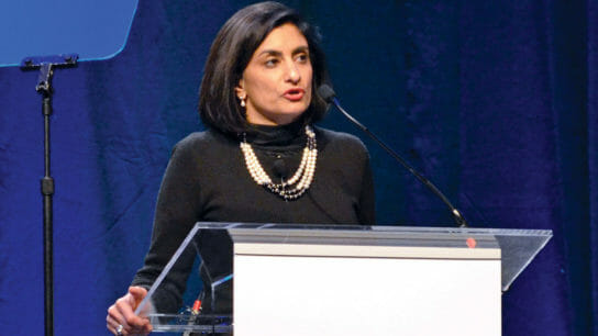 Seema Verma at a podium