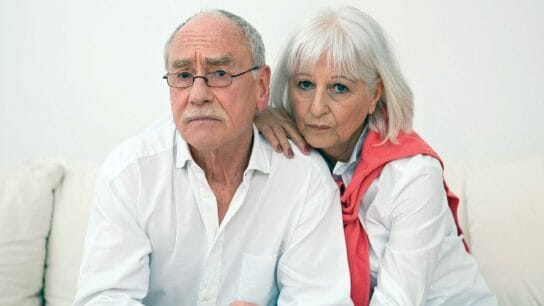 Worried older couple
