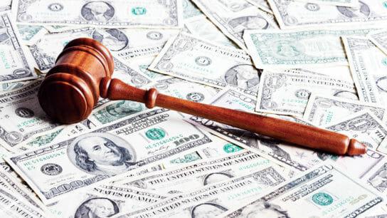 gavel on pile of money