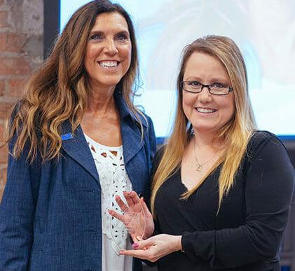 Debora Erksa receiving Rising Star award