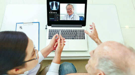 resident looking at doctor on computer screen
