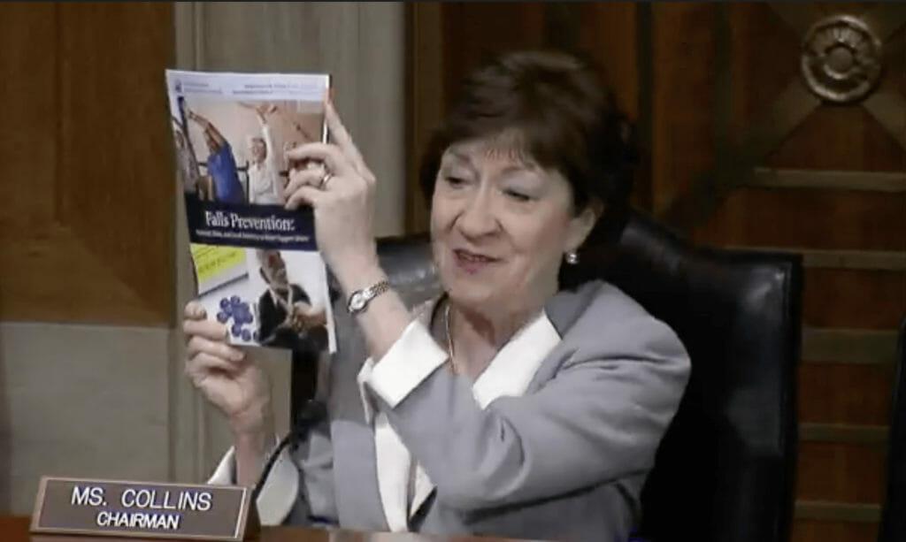 Sen. Susan Collins holding a report.
