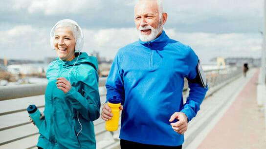 Older couple listening music and running