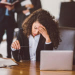 stressed out worker in front of laptop