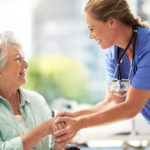 Woman caregiver interacting with female older adult