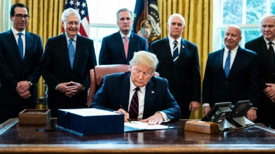 President Trump signing a document