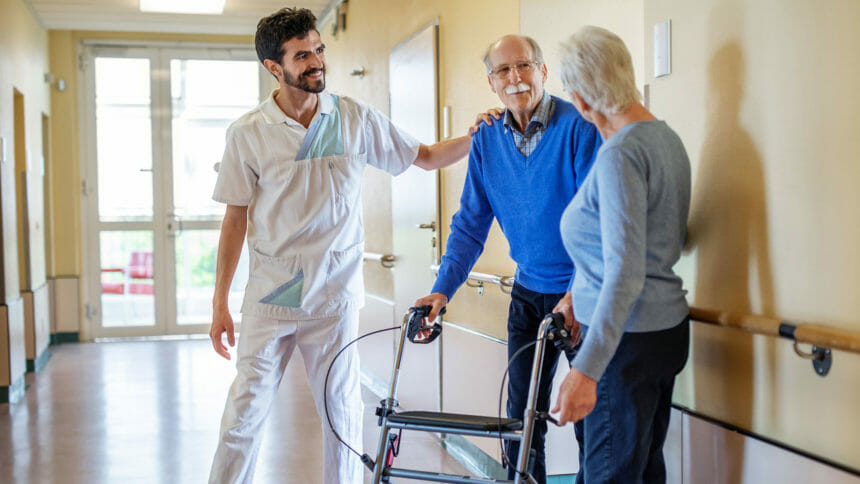 Older couple with healthcare worker