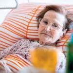 woman in nursing home bed