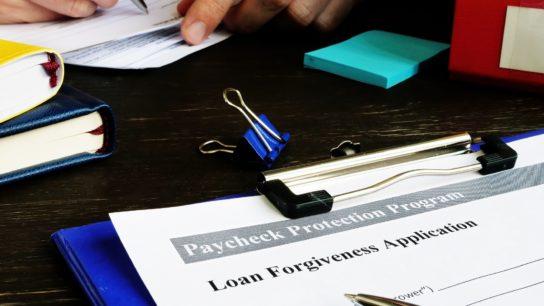 clipboard with loan application on it