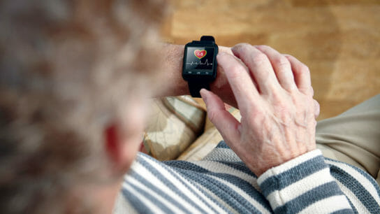 older adult looking at smart watch