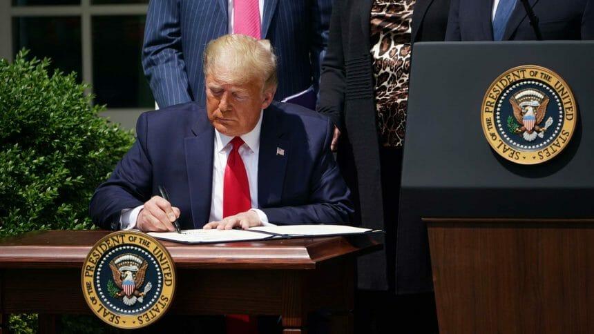 President Trump signing something