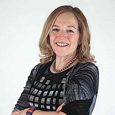 Ruth Katz with arms folded