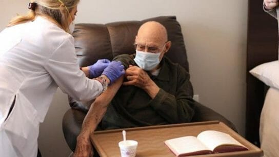 senior living resident gets vaccinated against COVID-19