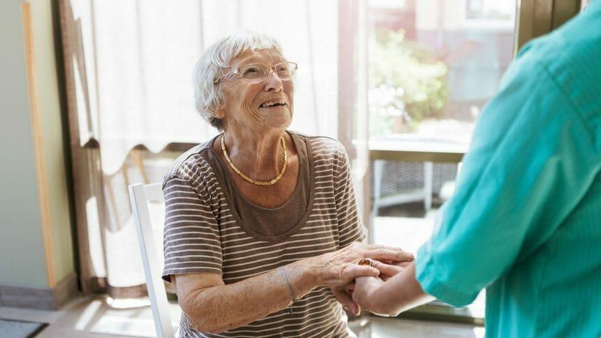 senior holding hand of healthcare worker