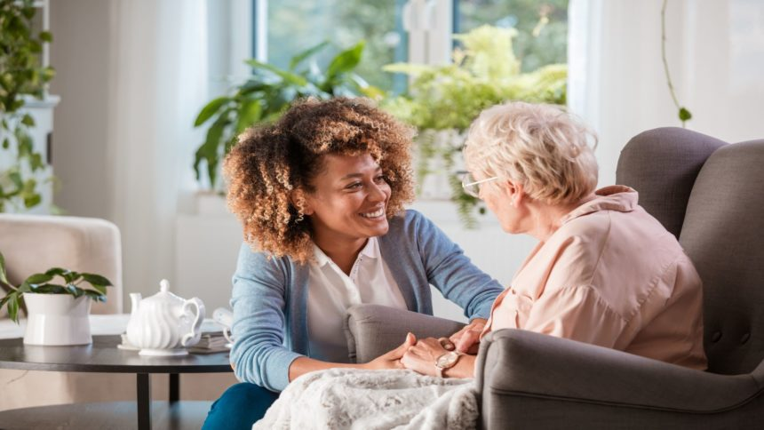 Caregiver tending to woman at home