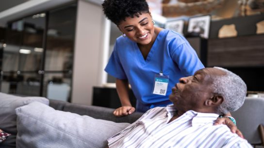 Home care worker tends to patient