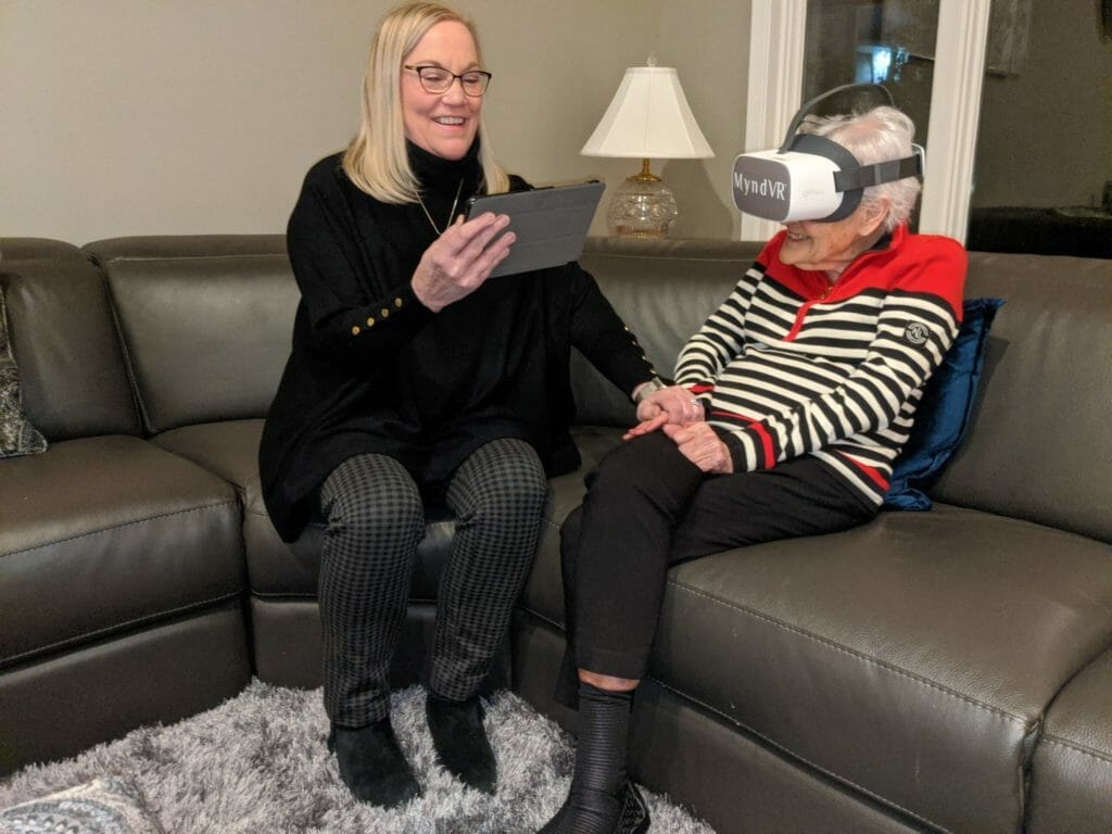 Image of senior woman and caregiver participating in a MyndVR experience.